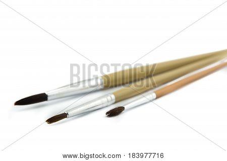 The paintbrush isolated on white a background