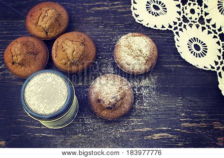 Close up of chocolate muffins on wooden table.Toning effect