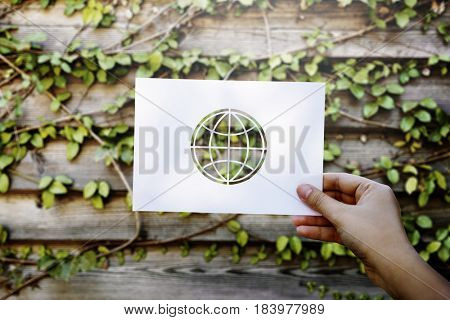 Hand Hold Globe Paper Carving with Wooden Background