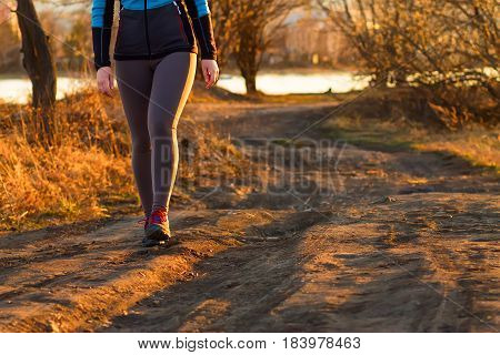 Cross-country trail running people at sunset. Runner couple exercising outside as part of healthy lifestyle