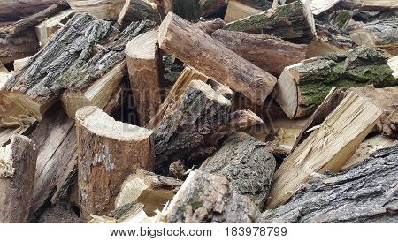 Throwing firewood on a pile. Stack with firewood
