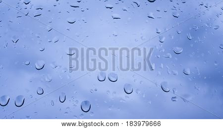 rain drops on window glass abstract background