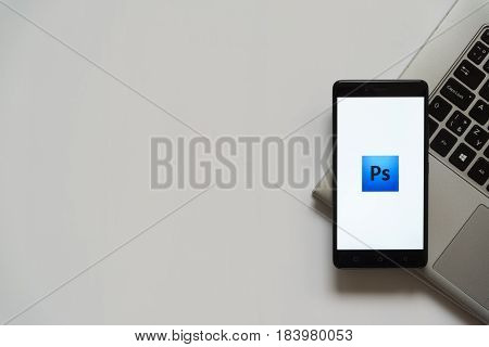 Bratislava, Slovakia, April 28, 2017: Adobe photoshop logo on smartphone screen placed on laptop keyboard. Empty place to write information.