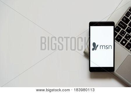 Bratislava, Slovakia, April 28, 2017: MSN logo on smartphone screen placed on laptop keyboard. Empty place to write information.