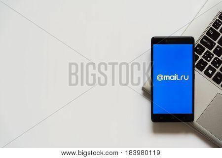 Bratislava, Slovakia, April 28, 2017: Mail.ru logo on smartphone screen placed on laptop keyboard. Empty place to write information.