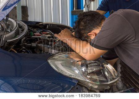 Checking A Car At Garage