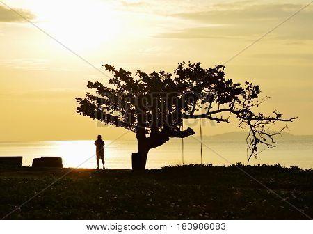 silhouette traveler man photo impress view of sea and sky on sunrise