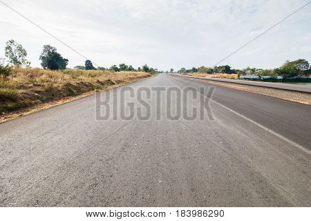 Striping road ahead in morning, raw road