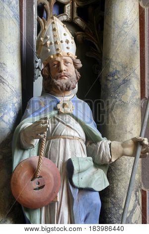 PISAROVINSKA JAMNICA, CROATIA - AUGUST 21: Saint Quirinus statue at the altar in the Parish Church of Saint Martin in Pisarovinska Jamnica, Croatia on August 21, 2011.