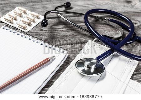 Close view of stethoscope on wooden desk