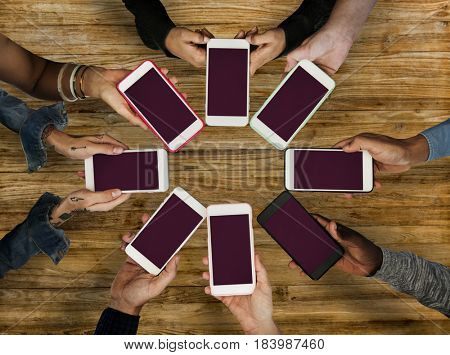 Group of people using mobile phone with blank screen