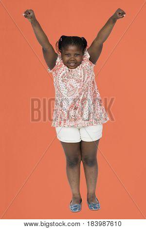 Little girl hands up studio portrait