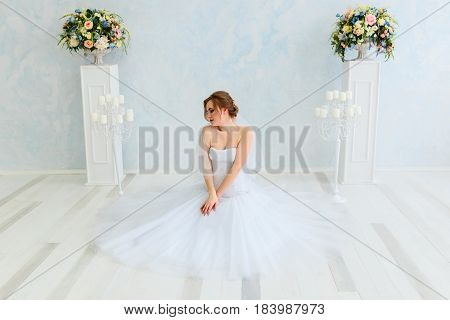 A bride in a beautiful dress. Wedding. Bride's morning. Happy Bride waiting groom.