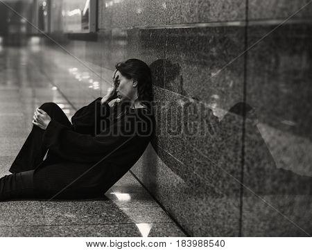 Adult Woman Sitting Hopeless on The Floor