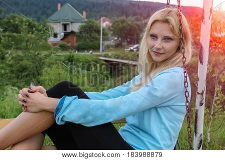 Beautiful young woman on rural landscape background
