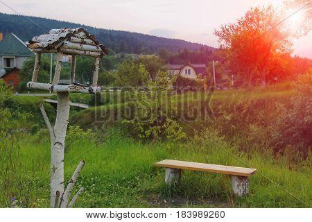 Wooden bench and birdhouse in Carpathians Ukraine