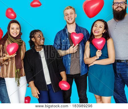 Group of Diverse People Holding Heart Balloons Cheerfully