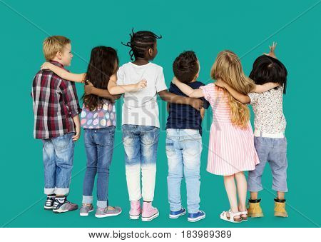 Group of children standing and huddle in rear view