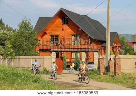 Schodnica Ukraine - June 30 2014: People riding bicycles. Carpathians