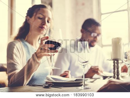 Woman Holding Red Wine Glass in a Classy Restaurant