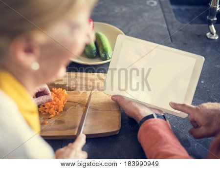 Senior Woman Cooking Food Kitchen Tablet