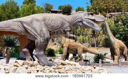 Algar Spain - April 8 2017: Realistic models of a Tyrannosaurus Rex and Diplodocus dinosaurus in the Dino Park of Algar. It is a unique entertainment and educational park. Spain