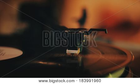 Record player turntable stock footage. A record player turntable with it's stylus running along a vinyl record, dropping stylus needle on vinyl record playing