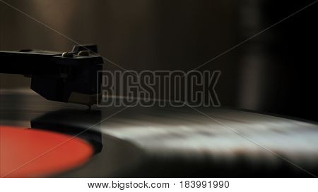 Record player turntable stock footage. A record player turntable with it's stylus running along a vinyl record.