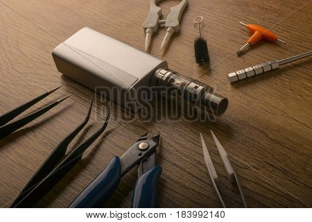 Vape Device Or Electronic Cigarette With Vaping Tools And Accessories.