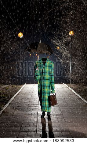 Invisible man with vintage umbrella under the rain