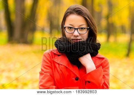 autumn portrait Korean girl in glasses outdoors