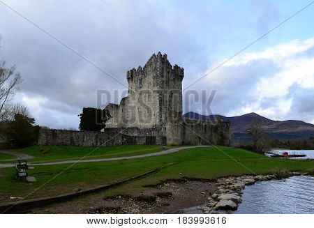 Storm clouds rolling over Ross Castle in Killarney Ireland.