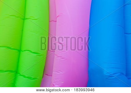 Colored fabric brochure in a diagonal position. Textured background