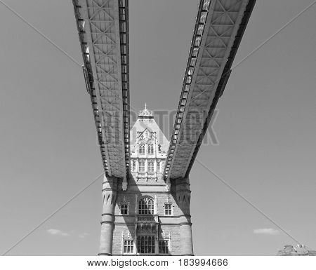 Looking up at the tower with its old and detailed architecture and support beams from Tower Bridge in London on a sunny summer day.