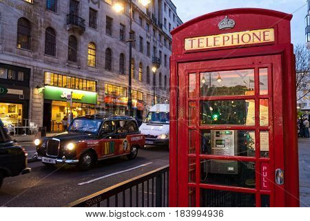 LONDON, UK - APRIL 10, 2017: Red telephone box and black cab on April 10, 2007 in London.
