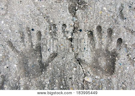 pair of hand prints imprinted in cement