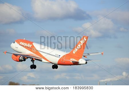 Amsterdam the Netherlands - April 7th 2017: G-EZFO easyJet Airbus A319-100 takeoff from Polderbaan runway Amsterdam Airport Schiphol