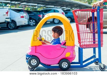 Child car seat put the product into supermarkets holiday