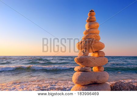 Concept of harmony and balance. Rock Zen at sunset. Balance and poise stones against the sea