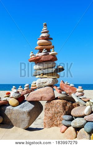 Big Rock Zen on the background of summer sea. Concept of harmony and balance.