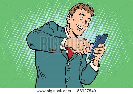 business handshake via smartphone. Pop art retro vector illustration. E-Commerce and online collaboration