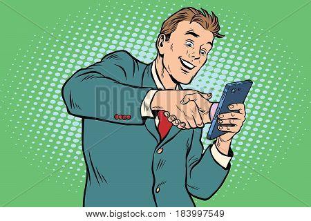 business handshake via smartphone. Pop art retro vector illustration. E-Commerce and online collaboration