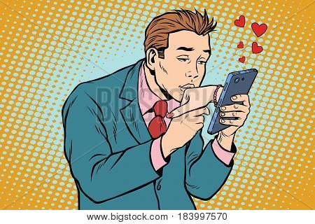 online date and love a man kisses a womans hand via smartphone. Pop art retro vector illustration