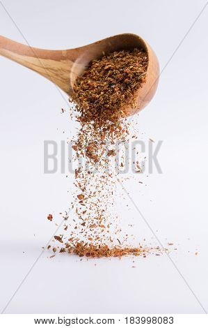 Falling Spices On A White Background