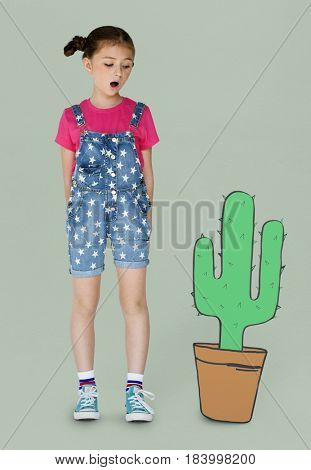 Little Girl Looking Papercraft Cactus