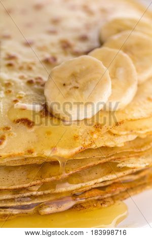 Thin Pancakes With Banana And Honey. Maslenitsa. Russian Pancakes On A Light Wooden Background. In A
