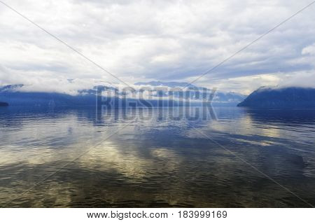 Siberia. Teletskoe lake, view of Cape Kuwan in the morning in cloudy weather