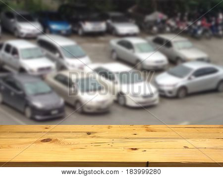 Empty wooden table space platform and blurred Parking lot background for product display montage.