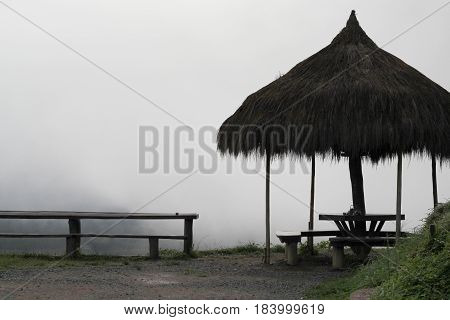 Seat on top of the mountain with fog covered.silhouette