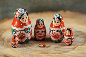 Trouble in matryoshka family. Russian doll on a wooden table. Matrioska art. poster